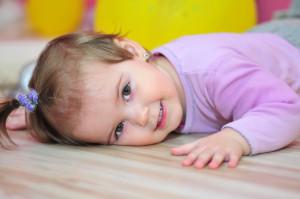 Happy little girl lying
